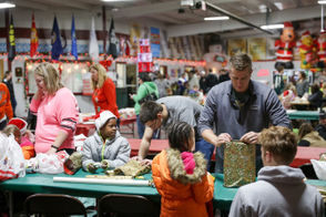 Volunteers wrap gifts during the annual Children's Christmas Shopping Spree, Saturday, Dec. 15, 2018 at Optimist Ice Arena in Jackson. (Nikos Frazier | MLive.com)