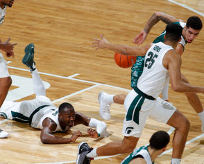 EAST LANSING -- Green Bay gave Michigan State its best shot and hung in the game for nearly 10 minutes. But that was all a road-weary mid-major could manage before it gave way to the offensive spectacle that is Michigan State this year. No. 9 Michigan State pulled away late in the first half for a 104-83 win on Sunday night at the Breslin Center. The Spartans showed no rust after an eight-day layoff for finals. They scored 64 first-half points and got offense from all facets while shutting down Green Bay for most of the middle portion of the game. Nick Ward made his first 11 shots and set a new career high with 28 points. Cassius Winston approached triple-double territory with 16 points, 12 assists and six rebounds. Joshua Langford (13), Matt McQuaid (12), Gabe Brown (11) and Foster Loyer (10) all also finished in double figures scoring. The Phoenix (6-6) came out hot and led Michigan State (9-2) through the first nine minutes of the game. But after that start, the Spartans promptly went on a 20-4 run and led outscored the Phoenix 44-11 over the final 12:43 of the half. After allowing the Phoenix to make 10 of their first 15 shots, Michigan State's defense held Green Bay to just two makes in its next 17 tries. The Phoenix, though, saw open looks late in the game to become the fourth team to top 80 points against the Spartans this year. The game was the first of four straight home games in late December and early January for the Spartans. The next will be on Friday against Oakland. Here are three observations about Michigan State's win over Green Bay: