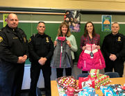 Palmer police union delivers coats to Palmer, Tracy elementaries for distribution to families in need