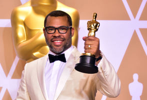 Director Jordan Peele poses in the press room with the Oscar for best original screenplay during the 90th Annual Academy Awards on March 4, 2018, in Hollywood, California.