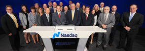 Brett Fulk, president of Riverview and Kirk Fox, CEO of Riverview and members of the bank's executive team and board of directors at the Nasdaq's closing ceremony on Aug. 28. Fulk is pictured in the front row, second from the left, and Fox is pictured in the front row, third from the left.