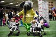 Alabama athletes greet kids with candy, games, autographs and more at Halloween Extravaganza