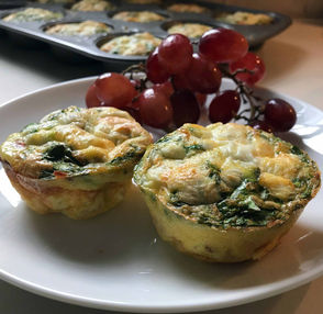 Homemade egg muffins – individual omelets baked in the cupcake tins – are a super solution to busy mornings during the holidays or any time.  The beauty of these little guys is that they can be adjusted to suit any taste or diet. Below you will find three variations on egg muffins, including a vegetarian one, one with no carbs and one that combines meat, eggs and potatoes.  They are so easy to make. Fill tins with chopped meats and vegetables. Then, scramble eggs with seasoning and spoon eggs over fillings.  Bake until firm.  These egg muffins can be made ahead and then stored in the refrigerator. They actually taste better the next day.  They also can be frozen and thawed as needed, making them perfect for a house full of guests or a busy family looking for quick, hot breakfasts any day of the week. Some people also call these mini frittatas or quiches.