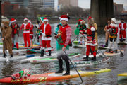 Santas, elves and reindeer ditch the sleigh and paddleboard Portland's Willamette River (photos)
