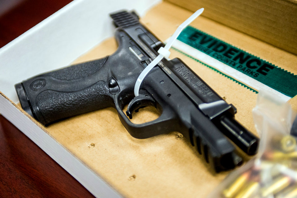 Fake badges, real 9mm guns on display as evidence in fake police case