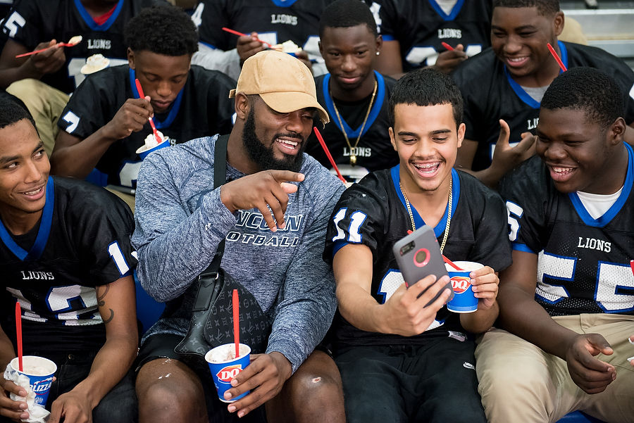 New York Giant surprises Jersey City football team with treats, donation