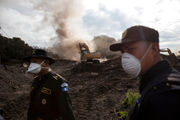 At Guatemala volcano, weather and danger hinder search