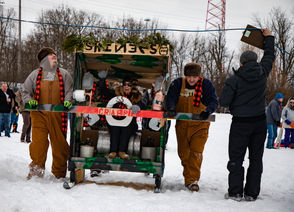 Team Moonshiners makes their way to the starting line of the race track for time trials during the sixth annual Outhouse Races on Saturday, Feb. 16, 2019 in Hoyt Park.