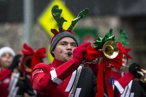 Members of the Saranac High School Marching Band perform during the ArtVan Santa Parade in downtown Grand Rapids on Saturday, Nov. 18, 2017.