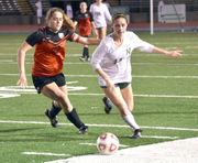Newman 5, McGehee 3: Brie Reginelli's hat trick powers district win