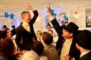 STATEN ISLAND, N.Y. -- You could say it was my first Bar Mitzvah. Well, not really my very first -- but Ariel Mirocznik's Bar Mitzvah was the first in a good number of years. And because preserving customs, rituals and traditions are after all the foundation of families -- and serve to remind us we are all part of a big history, we were delighted to attend. The memorable evening, steeped in rich family tradition, observed a culture that dates back thousands of years and lies deep within the Jewish heritage. FYI: Ariel celebrated his Bar Mitzvah recently at Young Israel of Staten Island, followed by a reception staged at LiGreci's Staaten in West Brighton, where 250 of his closest friends and family came to be part of the merrymaking