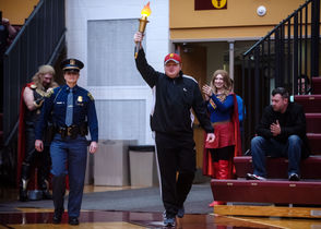Tyler Lawton, an athlete from Michigan, carries the torch during the opening ceremonies of the Special Olympics Michigan 2019 State Basketball Finals at Calvin College on Friday, March 15.