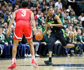 EAST LANSING -- First came the injury, then the foul trouble, then the ineffectiveness from Michigan State's best player. With eight minutes left in a tie game against Ohio State, it all combined to force Michigan State into an an unorthodox lineup: two non-rotation freshmen and an ailing guard trying to fend off an upset bid. But on a day that Michigan State's stars struggled for a variety of reasons, that unlikely group gave Michigan State the second-half boost it needed en route to a 62-44 win over the Buckeyes at Breslin Center. The win drew Michigan State (21-5, 12-3) even with Michigan for first place, a week ahead of the two teams' first meeting of the season. Purdue remains a half game behind in second place. Michigan State came back in the second half largely without Nick Ward, who emerged from the halftime locker room with a wrap on his left hand. He played just four minutes. His replacement, Xavier Tillman, picked up two fouls in less than two minutes of gameplay in the second half and had to sit as well, with four troubles. Michigan State also subbed out a struggling Cassius Winston with 8:40 left, leaving it with a lineup of Foster Loyer, Matt McQuaid, Kyle Ahrens, Kenny Goins and Thomas Kithier and the game tied. But that unlikely group produced Michigan State's best stretch of the afternoon: they opened with back-to-back 3-pointers from Goins and Ahrens. Goins added another bucket, while McQuaid hit a 3 and Kithier a layup to complete a 10-point run and give the Spartans their biggest lead of the game, 52-42 with 4:36 left. McQuaid led the Spartans with 14 points, going 4-for-6 from 3-point range. Winston finished with 13 points despite going 3-for-15 from the field. Goins added 10 points and 10 rebounds. That second-half run, plus some strong defense, helped the Spartans overcome a poor shooting day. Ohio State (16-9, 6-8) went on a 4-for-22 shooting stretch to close the game as Michigan State pulled away. Michigan State will remain at home to play R