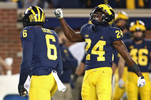 Michigan defensive back Lavert Hill (24) celerbates with linebacker Josh Uche (6) after Uche sacked Wisconsin quarterback Alex Hornibrook (12) during the second quarter of their Big Ten football game at Michigan Stadium in Ann Arbor on Saturday, October 13, 2018. (Mike Mulholland | MLive.com)