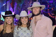 Debutante Corinne Moffett celebrates with boots and beads, Louisiana and Texas style