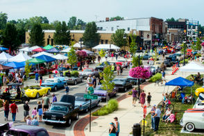 Hundreds roam Leroy Street to look at classic cars during a Back to the Bricks tune-up party on Thursday, Aug. 9, 2018 in Fenton. Jake May | MLive.com