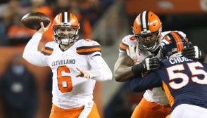 Cleveland Browns quarterback Baker Mayfield prepares to throw a pass as offensive tackle Greg Robinson holds off Denver Broncos linebacker Bradley Chubb in the second half Saturday.