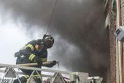 Firefighters battle past 'clutter' to extinguish apartment house blaze (PHOTOS)