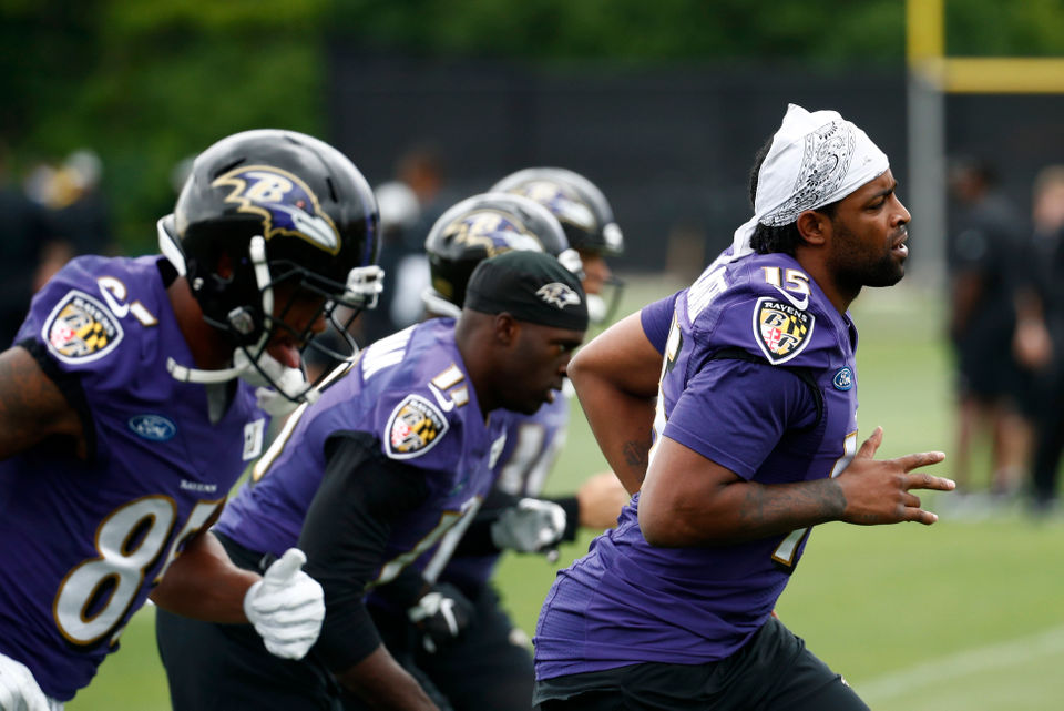 d5a7d19cdf0 Baltimore Ravens wide receiver Michael Crabtree, right, warms up at the  beginning of an NFL football training camp practice at the team's  headquarters, ...