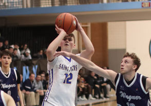 By CHARLIE De BIASE JR. Senior guard Chris Clancy poured in a career-high 31 points, including a 14-for-16 performance from the free-throw line, to lead short-handed St. Peter's to a 76-69 CHSAA AA victory over visiting Monsignor Scanlan on Sunday. The 4-0 Eagles, who trailed by eight on two different occasions in the first half, played Sunday's game without starting power forward Jamal Achille. The senior injured his ankle during warm-ups prior to Friday's game against Monsignor Farrell and although he played start-to-finish against the Lions, he was diagnosed with a sprained ankle and is expected to miss some time. In addition to Clancy, who buried three three-pointers, the Eagles also received a career-high 25 points from junior Liam Murphy (8 for 13 from the line, three treys) while guard Thomas Lotito (5 points, 9 assists) played an excellent floor game. The Crusaders came to New Brighton riding high following an 86-78 victory over defending state Federation AA champ Stepinac on Friday and jumped to a 14-7 lead at the end of the first quarter. But Clancy and Murphy combined for 16 second-quarter points as SP outscored Scanlan 23-13 to take a 30-27 lead at intermission. Murphy and Clancy then teamed for five, third-quarter treys as the Eagles lead ballooned to as many as 16. Scanlan fought back behind its full-court pressure to cut the host's lead to six midway through the final period, but Clancy and Murphy teamed to bury 17 of 22 free throws (Nabi Mwesiga added another) in the fourth to help SP hang on. Clancy also tied senior Mike Loffredo with a team-high seven rebounds while Murphy and fellow junior Joe Ramos grabbed six caroms apiece. Kobe Brea paced Scanlan with 21 points.