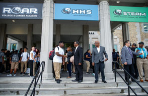 Students are greeted as they arrive on the first day of school at Harrisburg High School.