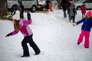 Little girls play in the snow before the the sixth annual Outhouse Races begin on Saturday, Feb. 16, 2019 in Hoyt Park.