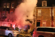 Blaze wrecks row home but no one injured, official says