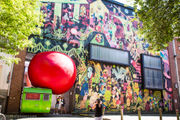 Where to see a massive red ball wedged into 5 local landmarks