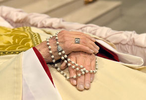 The hands of Rev. Thomas Costello holds a Holy Rosary as he lies in church. Mass of Christian Burial for Rev. Thomas Costello at the Cathedral of Immaculate Conception, Syracuse, February 22, 2019, Michael Greenlar | mgreenlar@syracuse.com