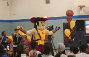 Cleveland leaders, kids celebrate Cavaliers work to refurbish rec center gym floor