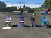 In Class: Students paint chairs to reflect kindness, respect