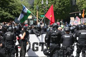 Patriot Prayer, antifa face off in downtown Portland on Saturday, Aug. 4, 2018.