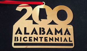 While many are official bicentennial souvenirs sold by the Alabama 200 committee, a few specialty products are also available.
