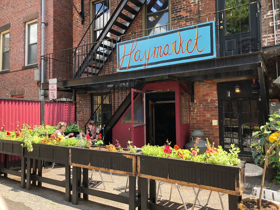The cafe offers outdoor seating through the back