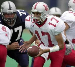 Port Richmond quarterback Agim Bajramovic looks to hand-off as Susan Wagner DT No. 77 Nichola Schirripa makes the rush on Dec. 7, 2002. Bajramovic tossed 11 touchdown passes in his junior season at Port Richmond.