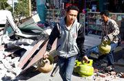 At least 98 dead after quake slams Indonesian island