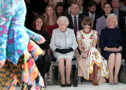 Stylish Queen Elizabeth II makes first visit to London Fashion Week (photos)