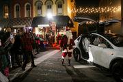 Tesla sleigh delivers Santa to Depot Town Christmas tree lighting