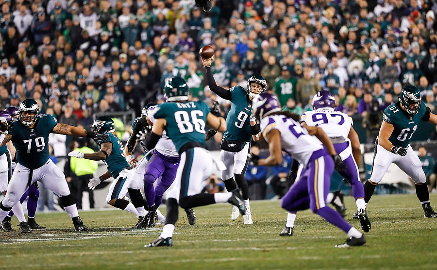 Philadelphia Eagles quarterback Nick Foles (9, center) completes a pass to Philadelphia Eagles tight end Zach Ertz (86) for a first down in the first quarter as the Eagles host the Minnesota Vikings in the NFC Championship game on Sunday, Jan. 20, 2018 at Lincoln Financial Field.