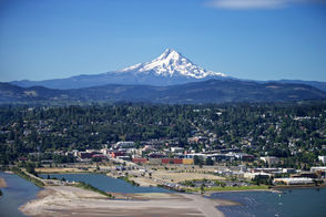 Mount Hood towers over Hood River, a top Oregon recreation town in the Columbia River Gorge.