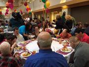 Massachusetts politicians serve up turkey and gratitude at Goodwill Boston Thanksgiving dinner