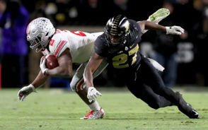 Ohio State running back J.K. Dobbins (2) is tackled by Purdue  safety Navon Mosley (27) in the second quarter of Saturday's win by the Boilermakers. (Marvin Fong, The Plain Dealer)