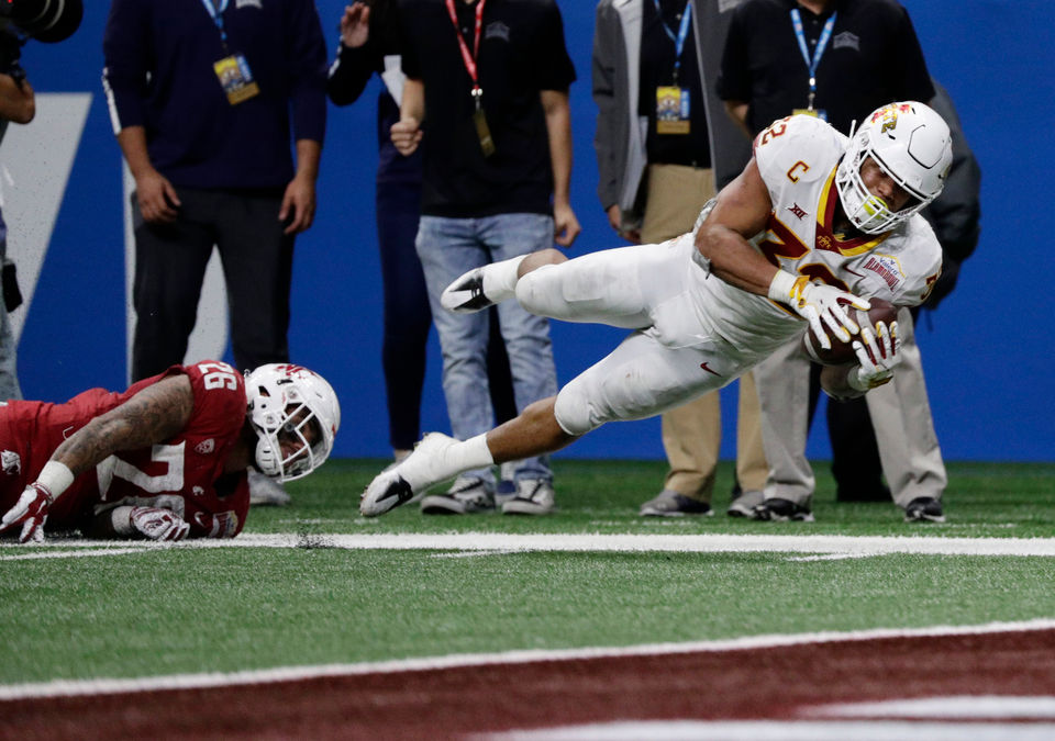 Iowa State running back David Montgomery (32) is tripped up short of the  goal line by Washington State defensive back Hunter Dale (26) during the  second ... e167f464c