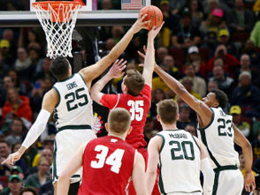 Michigan State forward Kenny Goins (25) blocks a layup by Wisconsin forward Nate Reuvers (35) during the second half of their Big Ten Tournament semifinal game at the United Center in Chicago on Saturday, March 16, 2019. Michigan State won the game, 67-55, to advance to the Big Ten Tournament championship game. (Mike Mulholland | MLive.com)