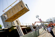 Prefabricated apartment unit dropped into place at old Tiger Stadium site