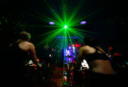 Cycling studio takes workouts to another level with lightshow and rhythmic riding