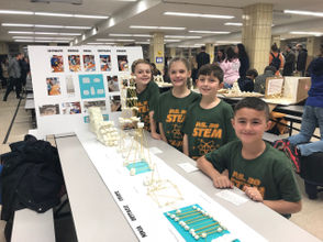 """PS 30 STEM students John Bonura, Emma Chiusano, Jackson Girardi and Evan McKibbin created the Ultimate Bridge Ninja Obstacle Course. John said that the group was inspired """"because we all know about the American Ninja Warrior show."""" The students dubbed themselves the Bridge Ninjas, and thanked their science teacher. They received an Honorable Mention for their work."""