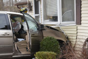 Driver hurt when minivan crashes into home (PHOTOS)