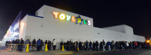 Black Friday shoppers line up for the opening of Toys R Us in in this 2012 file photo.