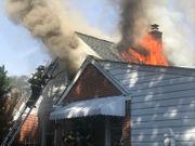 Firefighter hurt battling 2-alarm blaze in home (PHOTOS)
